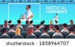female doctor giving speech at... | Shutterstock .eps vector #1858964707