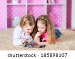 little sisters playing on a...   Shutterstock . vector #185898107