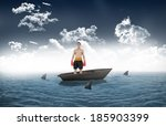 boxer standing against sharks... | Shutterstock . vector #185903399