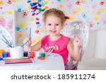 little girl draws sitting at... | Shutterstock . vector #185911274