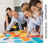 business colleagues arranging...   Shutterstock . vector #185916599