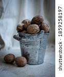 Nuts In Metal Bucket And White...