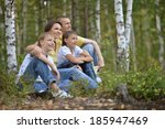 happy family sitting under the... | Shutterstock . vector #185947469