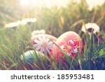 Easter Eggs And Daisies In The...