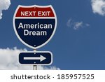 Small photo of American Dream this way, Blue and Red Interstate Sign with word American Dream and an arrow with sky background