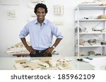 architect with models of houses ... | Shutterstock . vector #185962109
