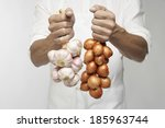 Chef Holding Bunch Of Garlic...