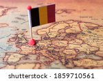 Small photo of Belgium marked with a flag on the map. Flag of Belgium on the world map. The concept of travel and tourism.