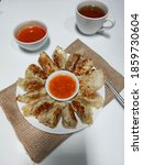 Small photo of Chinese Dumplings (guo tie) is a Culinary Specialty of Shandong, China