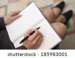hand taking note | Shutterstock . vector #185983001