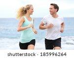 running couple jogging... | Shutterstock . vector #185996264