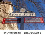 Close up, isolated image of a sign post located in the town center of Rockville, Maryland showing directions of shops, courts and government offices. Rockville is the county seat of Montgomery County.