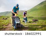 Hikers Pack Their Backpack At...