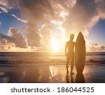 surfer man standing on  beach...   Shutterstock . vector #186044525