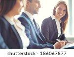 smiling businesswoman looking...   Shutterstock . vector #186067877