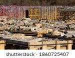 Rows Of Firewood Stacked On...