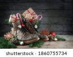 Old Hiking Boots Filled With...