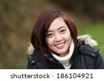 attractive friendly young asian ... | Shutterstock . vector #186104921