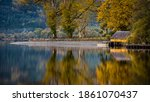 A Small Yellow Boathouse In The ...