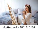 Woman Paints Picture On Canvas...