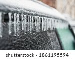 Car covered with ice and...