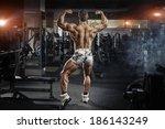 bodybuilder man posing in the... | Shutterstock . vector #186143249