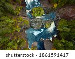 Incredible look down travel aerial photograph of Saxon Falls waterfall, cascades and whitewater rapids meandering through the rocks on the Montreal River on the border between Wisconsin and Michigan.