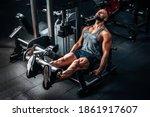 Muscular Man Using Weights...