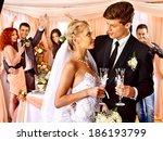 happy wedding couple drinking... | Shutterstock . vector #186193799