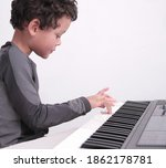 Boy Playing The Piano Keyboard...