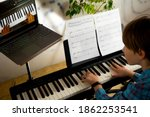 Boy learning to play the piano...