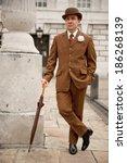 sharp dresser in brown suit and ... | Shutterstock . vector #186268139