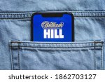 Small photo of Gibraltar, Gibraltar - November 27 2020: William Hill betting app logo on the screen mobile phone in jeans pocket. William Hill is a sports bookmaker registered in Gibraltar.