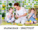 teacher and two sisters making... | Shutterstock . vector #186273137