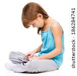 young girl is using tablet... | Shutterstock . vector #186284741