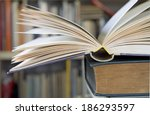 opened book close up with... | Shutterstock . vector #186293597