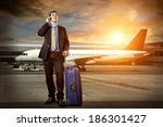 businessman with baggage in... | Shutterstock . vector #186301427