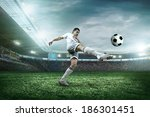 soccer player with ball in... | Shutterstock . vector #186301451