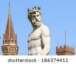 statue of neptune with towers...