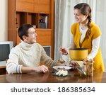 ordinary girl serving soup her... | Shutterstock . vector #186385634
