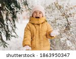 Toddler Girl Happy With Snow...