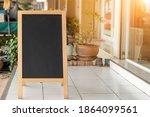 wooden rustic blackboard in... | Shutterstock . vector #1864099561