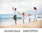 happy young family walking on... | Shutterstock . vector #186419924