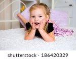 cute little girl in dress on... | Shutterstock . vector #186420329