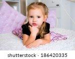 cute little girl in dress on... | Shutterstock . vector #186420335