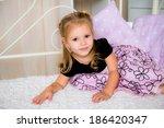 cute little child in dress on... | Shutterstock . vector #186420347