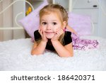 cute little girl in dress on... | Shutterstock . vector #186420371