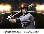 baseball player on a orange... | Shutterstock . vector #186423254