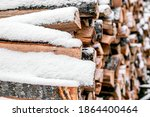 Snow Covered Firewood. Stack Of ...