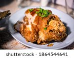 Small photo of Pork hock in German with sauces delicious food. Deep fried pork knuckle ,Thai style serve with seafood sauce. Crispy pork knuckle or German Pork Hocks on wood board.